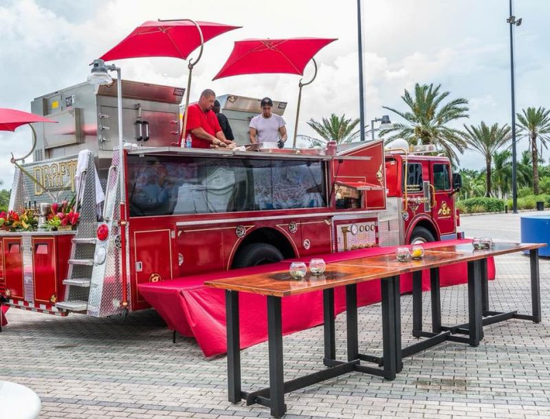firetruck converted into restaurant style food truck
